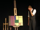 Mondriaan reacting in horror to a painting containing green, purple and brown